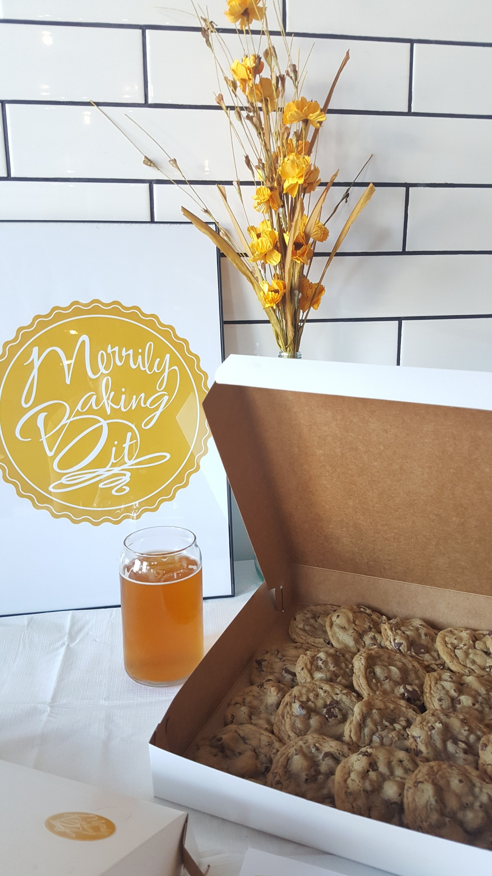Merrily Baking It sign, beer, cookies, flower